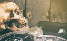 Dead Skull over movie film and video tape. Vintage filter stock photos