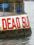 Dead Slow warning sign at the entrance to Paignton Harbour in Devon. UK royalty free stock image