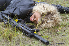 Dead Spy with machine gun Stock Photo
