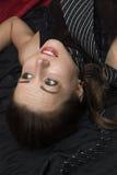 Dead strangled woman lying on the floor stock images