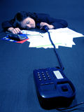 Dead tired. Working girl sleeping on the desk Stock Photography