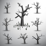 Dead tree on grave yard Stock Photography