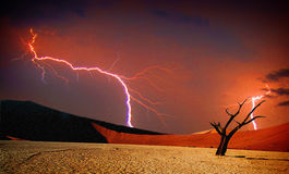 Dead valley, Sossusvlei. Lightning at Dead Valley, Sossusvlei in the Namib desert, rain is coming Stock Images