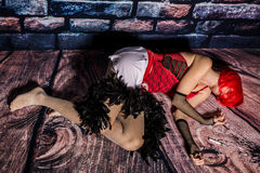 Dead woman. Prostitute laying down on the floor after assault royalty free stock photo