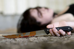 Dead Woman with Knife Royalty Free Stock Image