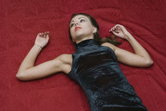 Dead woman lying on the floor. Dead woman on the floor. Studio shot Stock Images