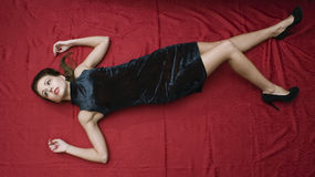 Dead woman lying on the floor Stock Photos