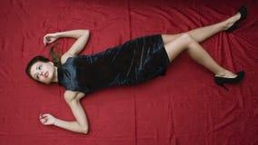 Dead woman lying on the floor stock photos