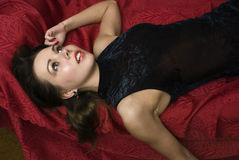 Dead woman lying on the sofa. Studio shot Royalty Free Stock Photography