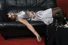 Dead woman lying on the sofa. Stock Photos