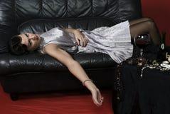 Dead woman lying on the sofa. stock photos