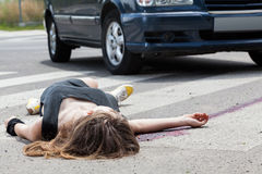 Dead woman lying on a street. After road accident Royalty Free Stock Photography