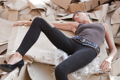 Dead woman in paper cartons stock image