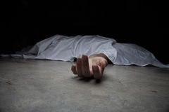 The dead woman's body. Focus on hand Stock Image