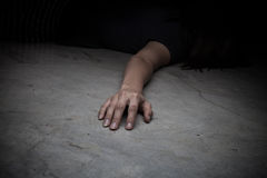 Dead woman's body. Focus on hand Stock Photo