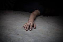 Dead woman's body. Focus on hand. The dead woman's body. Focus on hand Stock Photo