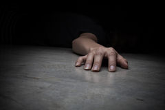 Dead woman's body. Focus on hand Royalty Free Stock Image