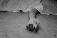 Dead woman's body. Focus on hand Royalty Free Stock Photo