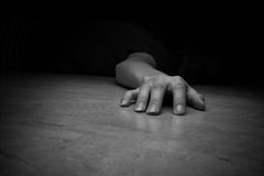 Dead woman's body. Focus on hand Royalty Free Stock Photography