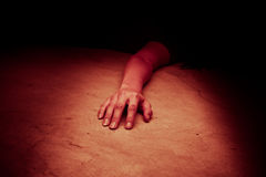 The dead woman's body. Focus on hand. Stock Photography