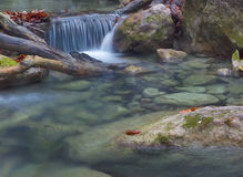 Dead wood and water cascade. Little waterfall in Crimea mountains in autumn Stock Image