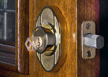 Deadbolt Lock. On mahogany front door Royalty Free Stock Photography