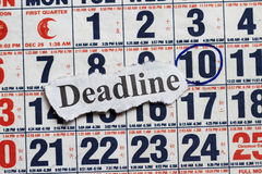 Deadline. Cutout in a calendar with date encircle Royalty Free Stock Photo