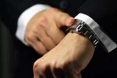 Deadline. A businessman looking at his watch, deadline/due theme Royalty Free Stock Photo