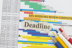 Deadline. Abstract - newspaper cutout with schedule chart background Royalty Free Stock Images