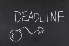Deadline. And a bomb on blackboard with chalk Stock Photos