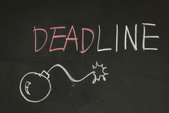 Deadline. And a bomb on blackboard with chalk Royalty Free Stock Photos