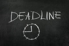Deadline. And clock drawed on blackboard with chalk Stock Photo