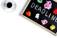 Deadline concept on board at white background top view stock photos