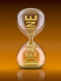 Deadline concept. 3D concept with hourglass and word deadline Royalty Free Stock Photography