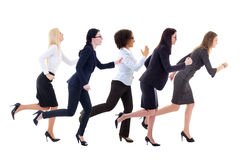 Deadline concept - side view of running business women isolated Stock Photos