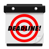 Deadline - Hanging Wall Calendar. The word Deadline and a red target on a hanging wall calendar Royalty Free Stock Photography