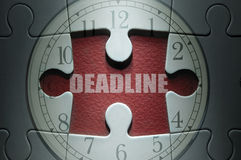 Deadline puzzle. Missing piece from a clock jigsaw puzzle with deadline in the center Royalty Free Stock Photography