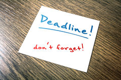 Deadline Reminder On Paper Lying On Wooden Cupboard Stock Photos