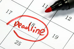 Deadline sign written with pen on paper Stock Photo