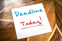 Deadline Sticky Note On Paper For Today Lying On Wooden Table Royalty Free Stock Photography