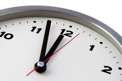 Deadline. 11:57 on the white wall clocks isolated Royalty Free Stock Photos