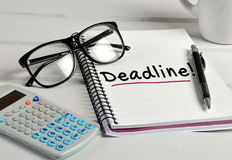 Deadline word on notebook Royalty Free Stock Photo