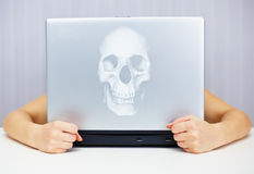 Deadly laptop connected to Internet Royalty Free Stock Photography