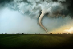 Deadly Tornado. An illustration of deadly tornadoes destroying farmland in Oklahoma under a raging stormy sky Stock Images