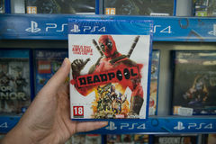 Deadpool. Bratislava, Slovakia, circa april 2017: Man holding Deadpool videogame on Sony Playstation 4 console in store Stock Photos