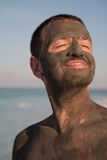 Deads Sea dirt. Dirt on men face on Dead Sea Stock Image