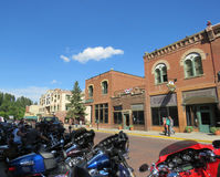 Deadwood South Dakota historic downtown, motorcycles and tourists. royalty free stock image