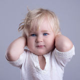 Deaf baby blue eyes blonde Stock Photography