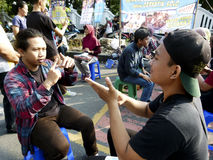 Deaf. Citizens interact with deaf persons in a public space in the city of Solo, Central Java, Indonesia stock photography