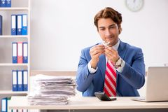 The deaf employee using hearing aid in office. Deaf employee using hearing aid in office royalty free stock photos